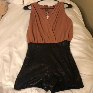 Romper (Top attaches to shiny shorts) Size Small